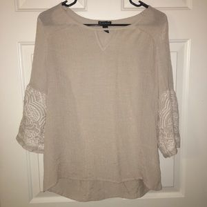 Tan blouse with floral pattern